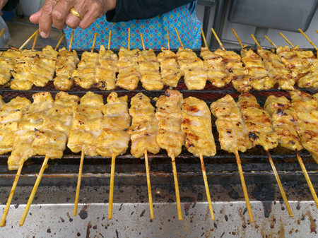 appetizer dish of traditional Thai street food recipe, Pork Satay Grilled marinated pork skewer stick barbecued on charcoal fire grill. Thailand Asia Food Travel, Fast Food, Culinary, Cuisine, Gourmet Stok Fotoğraf