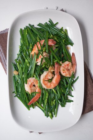 stir-fry flowering chinese chives with prawns and edamame in white plate Stok Fotoğraf