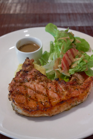 grilled pork chops with sweet and spicy salsa white plate