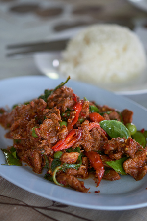 Spicy fried deer Thailand food on blue plate and selective focus