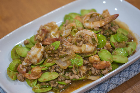 Fried shrimp and shrimp paste with Parkia Speciosa Native Thai food on white plate