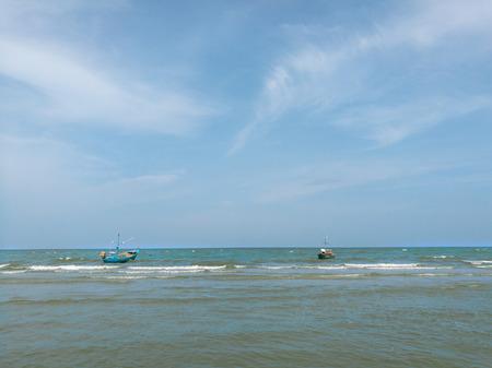 Sea wave foam and white sand beach on huahin