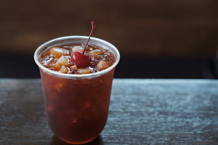 Iced tea. Summer cold drink with black tea red cherry fruits mint and ice. Stok Fotoğraf