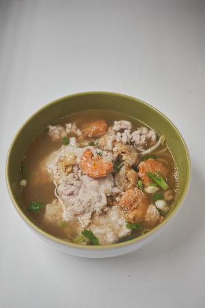spicy pork stew noodle soup space for text
