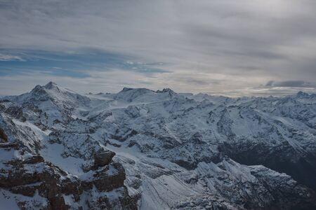 View from Mt. Titlis in Switzerland in winter. The Titlis is a mountain, located on the border between the Swiss cantons of Obwalden and Bern, it is usually accessed from the town of Engelberg on its northern side.