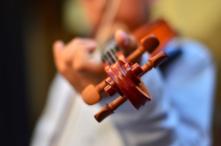 cellos: Child playing a violin. Blur style background. Stock Photo