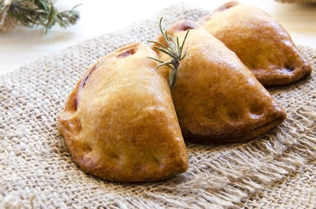 Closeup of typical spanish empanadillas, small meat or tuna fried pies, Standard-Bild