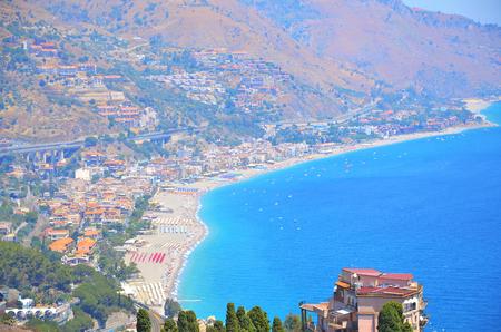 Spisone beach viewed from Taormina, Sicily, Italy