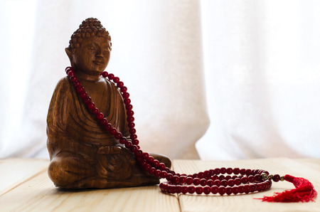 Closeup of  buddha and  mala beads for meditation
