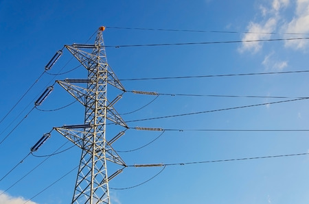Power transmission tower on blue sky