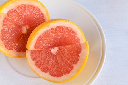 Close up of grapefruit fruit often include in weight loss programs .Healthy fruit background.