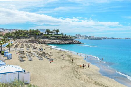 Beautiful coastal view of  El Duque beach with warm turquoise water and gold sand in Costa Adeje, Tenerife, Canary islands, Spain.   Reklamní fotografie