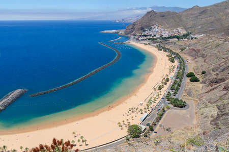 Playa de Las Teresitas with turquoise water and gold sand located in near the village San Andrés in Tenerife, Spain. Las Teresitas beach view from above.