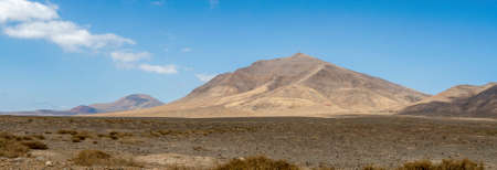 The spectacular volcanic landscape background in road to Papagayo beach in Lanzarote, Canary Islands, Spain. Panoramic view. Archivio Fotografico