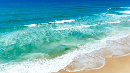 Ocean turquese waves and gold sand coastline.Tropical sea nature background