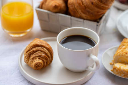 French breakfast, hot cup of coffee with croissants and orange juice. Good morning concept background. Archivio Fotografico