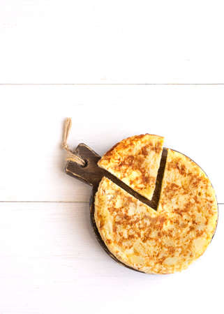 Top view of Tortilla, Spanish omelette made with eggs and potatoes .Copy space Archivio Fotografico