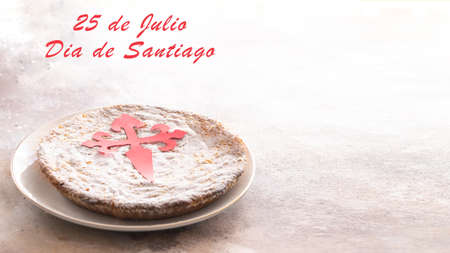 Tarta de Santiago (St. James cake) famous spanish almond cake typically made in Galicia on white background.Phrase 25 Julay St. James Day in Spanish