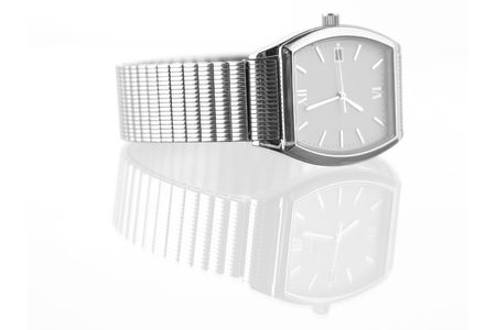 silver toned mans wristwatch on white ground, showing reflection photo