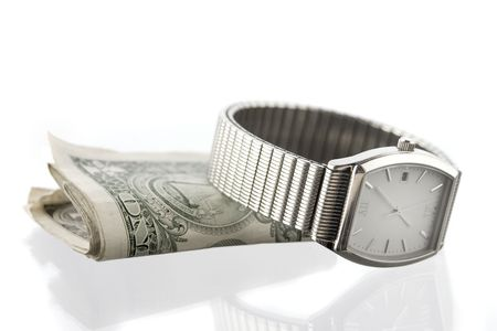 folded bills under silver-toned mans watch, on white ground with some reflection photo