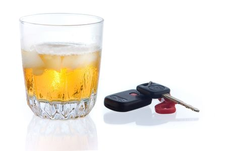 whiskey on the rocks with car key on white ground, with some reflection photo