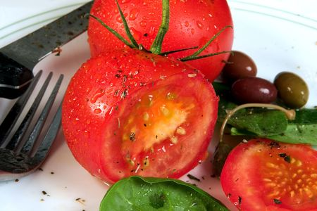Tomato salad with cracked pepper, basil and olive oil.