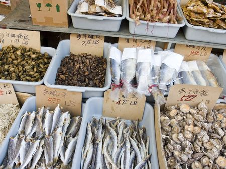 bins of dried seafood and mushrooms at the seafood market in China town, priced and labeled in Chinese. Stock Photo - 812323