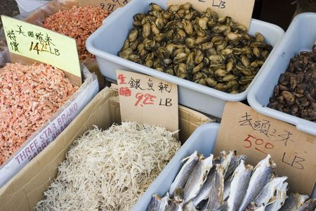 priced: dried shrimp, dried fish, oysters, mussels, dried shredded fish, labeled and priced, at the seafood market in China town