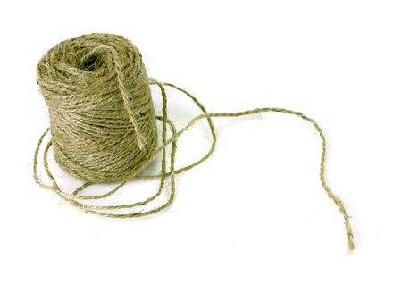 wrapped up skein of twine on white ground