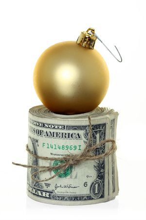 Money Roll with Christmas Ball Ornament Sitting on Top, Isolated against White