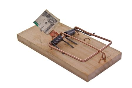baited: Mouse trap baited with money, isolated on white ground.
