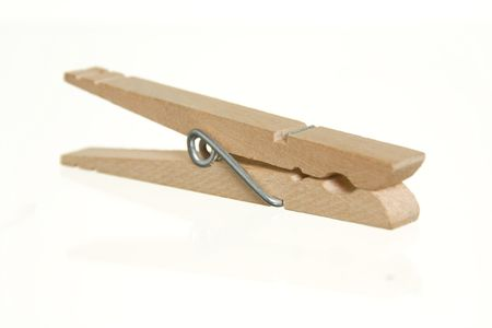 Wood clothespin against white ground.