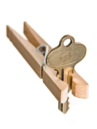 pinched: Mortgage crises concept: house key pinched by clothespin.