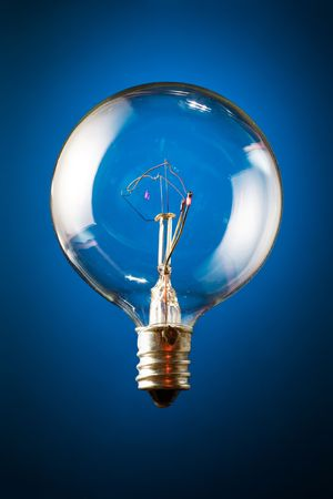 incandescent: Edisons round incandescent bulb on blue gradient background.