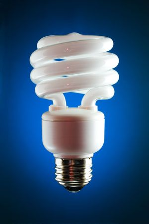 resourceful: Back lit compact fluorescent bulb with blue gradient background. Stock Photo