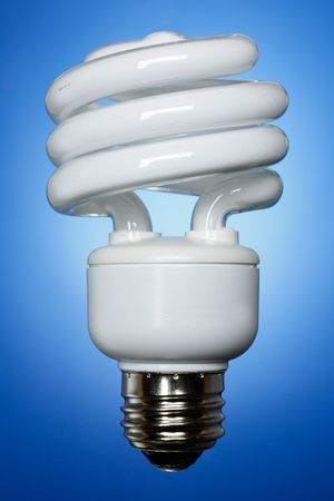resourceful: Straight forward compact fluorescent lamp on soft blue gradient background.