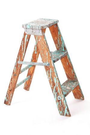 Used, paint-covered step stool, isolated against white background. Stok Fotoğraf