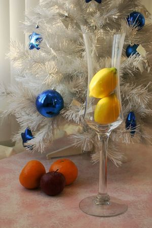 Lemon in glass, fruit and herring-bone with blue christmas decoration