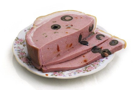 Pieces of the cut ham with olives Stock Photo