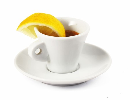 Espresso in small cup with lemon
