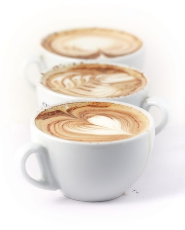 row of 3 cappuccino cup (short depth of field, first in focus) Stock Photo