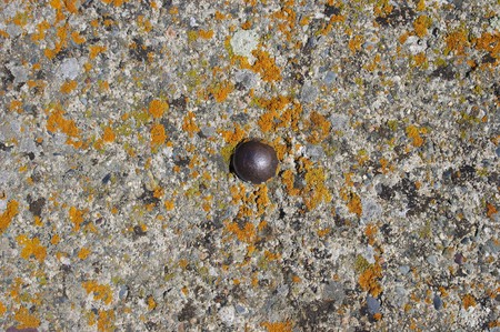a rust metal artifact on old concrete