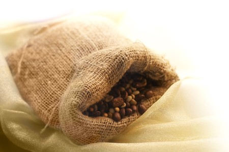 the Linen bag with Coffee grains. shallow depth of fild Stock Photo