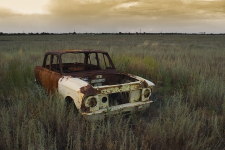 abandoned car: abandoned in the desert the old rusty cab of the passenger car Stock Photo