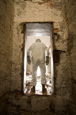 The man in a hole of destroyed wall photo