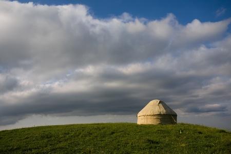 Kazakh yurt stands on a green hill