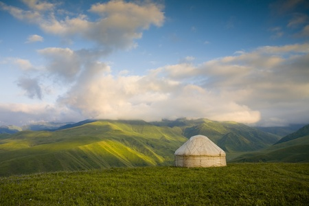 Kazakh yurt stands among the green hills