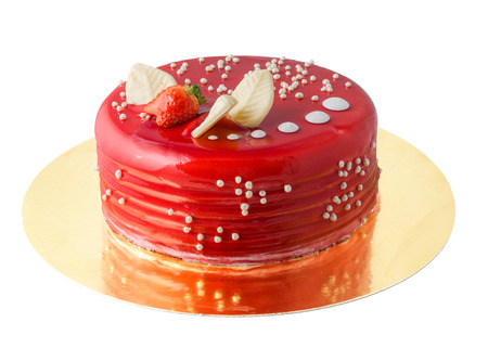 Cake with red glaze, strawberry and white chocolate on White Background Stock Photo