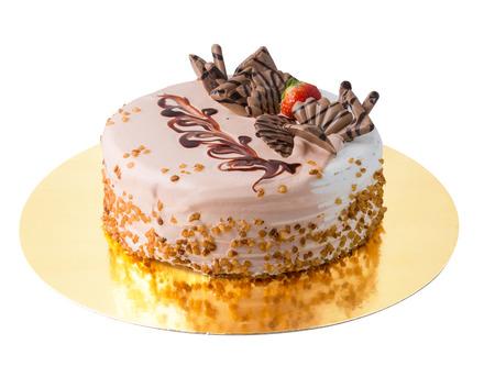 Isolated Cake with glaze and milk chocolate on White Background Stock Photo