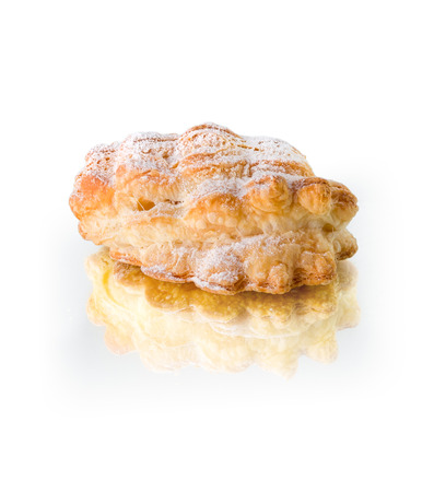 Sweet puffy bun with powdered sugar, isolated on white background